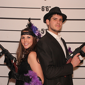 Atlanta Murder Mystery party guests pose for mugshots